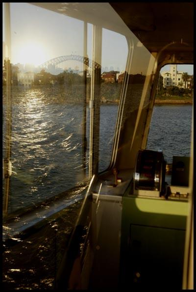 Ferry Ride to Cremorne wharf, with the Harbour bridge reflecting in the window of the ferry wheel house